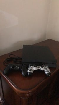PS4 2 controllers jet black and camp Dix Hills, 11746