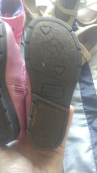 pair of pink leather side-zip boots