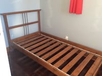 brown wooden bed frame with white mattress Mascouche, J7L 3H2