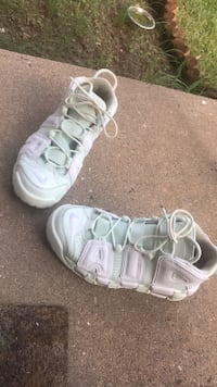 Pair of white-and-pink nike sneakers. Daughter wants to sell it to buy new shoes. Centreville, 20120