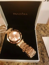 Pandora watch one rose gold and two silver and gol