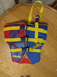 red, yellow, and blue printed life vest