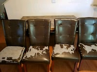 four brown wooden framed black leather padded chairs El Paso, 79907