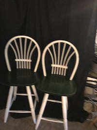 two black-and-white wooden windsor chairs null