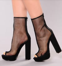 Pair of black leather heeled boots Towson, 21286