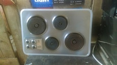 Hide away Stainless stove top, oven,  and hood