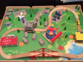 Like new! Wood train table with lots of trains and tracks!