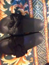 pair of black leather boots Wichita, 67209