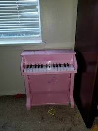 pink upright piano