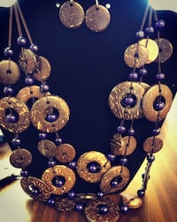 purple and gold-colored beaded necklace