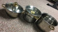 three stainless steel cooking pots