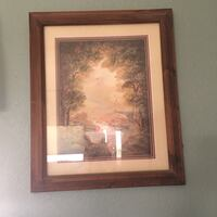 rectangular brown wooden framed painting of trees