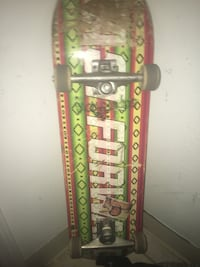 green and red skateboard