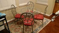 round glass top table with four chairs dining set Benicia, 94510