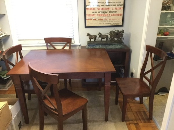 Brown table & 4 chairs.  Excellent shape.  Pottery Barn like.  Buy all for one price.
