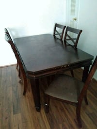 rectangular brown wooden table with six chairs Bryan, 77802