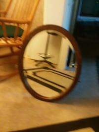 round brown wooden framed mirror 2286 mi