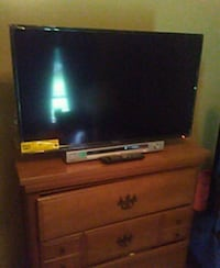 black flat screen TV with brown wooden TV stand Spencer, 47460
