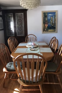 Solid oak dining room set with eight chairs,with table extension.