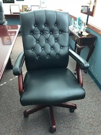 black leather padded rolling armchair ZEPHYRHILLS