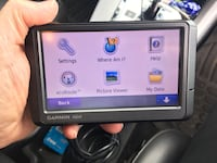 GPS - Garmin nuvi 250 series. Works great!!!  Includes dash mount, case, manual, power cord. Fun to use on a trip Orangeville, 61060
