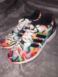 pair of multicolored floral low-top sneakers