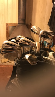 assorted Nike golf clubs