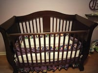 baby's brown wooden crib and brand new mattress Knightdale, 27545