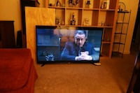 black flat screen TV and brown wooden TV stand Baltimore, 21207
