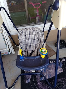 baby's blue and gray Graco portable swing