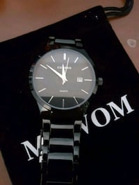 round black analog watch with silver link bracelet New Westminster, V3M 3N9