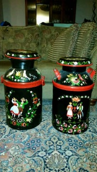 two black-and-red floral ceramic jars 781 km