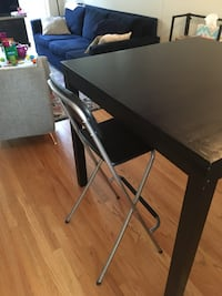 Black square wooden high top table and black foldable stools Chicago, 60614
