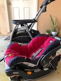baby's red and black carrycot system