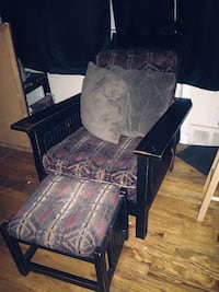 two brown wooden framed black padded chairs 380 mi