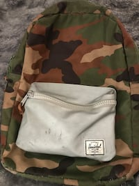 white, brown, and green Herschel camouflage backpack