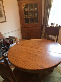 Oval brown wooden dining table, extension, 4 chairs  and hutch Manassas, 20110