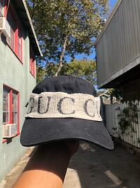 DESCRIPTION The Gucci logo is presented on a wide headband that wraps around the baseball cap. The athletic influenced design is reminiscent of a sweatband, finished with a vintage treatment. Oakland, 94607
