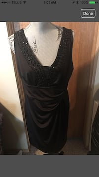 Women's black sleeveless dress With beads around neck line Calgary, T3G 4E1