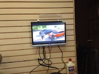 black flat screen TV with remote Fayetteville, 28303