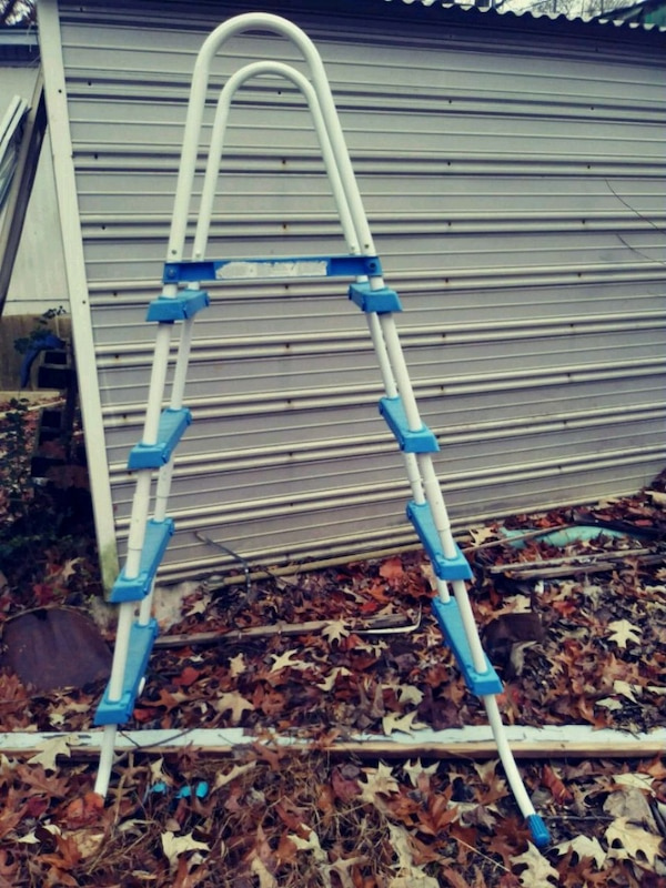 blue and white swimming pool ladder