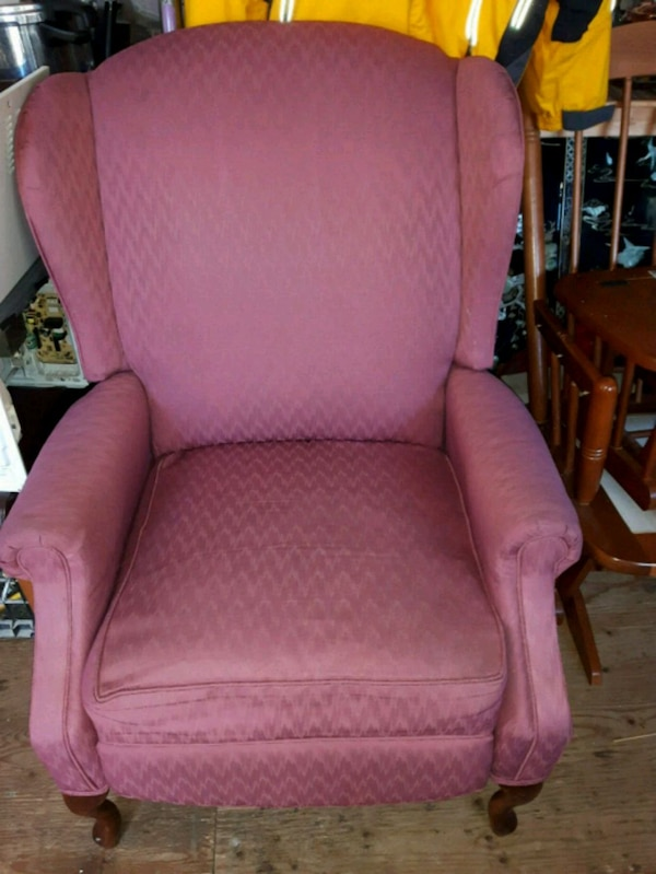 pink fabric padded wing chair