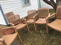 three brown wooden armchairs and table