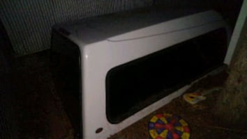 white canapy in excellent condition, windows intact /carpeted inside.