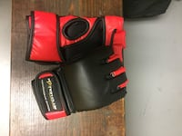 New pair of red and black MMA gloves