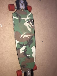 green, black, and brown camouflage skateboard Indian Harbour Beach, 32937