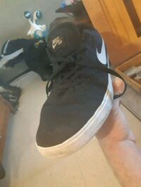 pair of black-and-white Nike sneakers Winnipeg, R3B 3C3