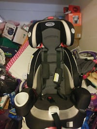 toddler's gray and black Graco car bucket seat