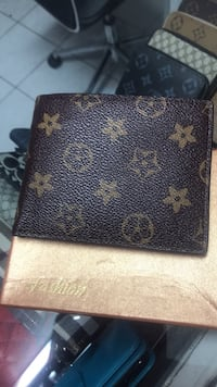 black and brown Louis Vuitton leather wallet 3119 km