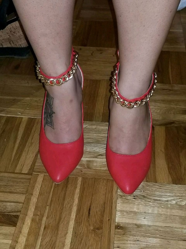 Size 6 pair of red leather pointed toe pumps